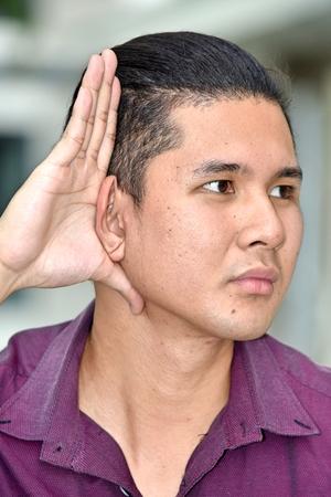 A Filipino Person Hearing Banco de Imagens
