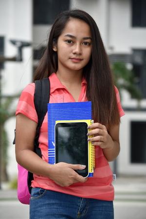 Unemotional Minority Student With Notebooks 版權商用圖片