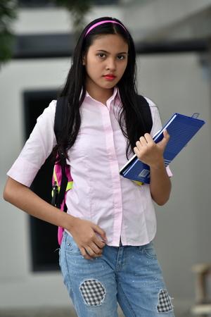 A Posing Girl Student 版權商用圖片