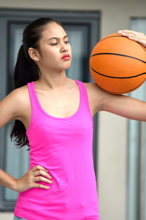 Unemotional Fit Asian Teen Athlete Female Basketball Player