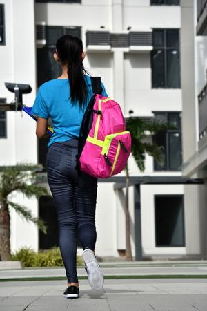 Female Student Walking On Campus 版權商用圖片