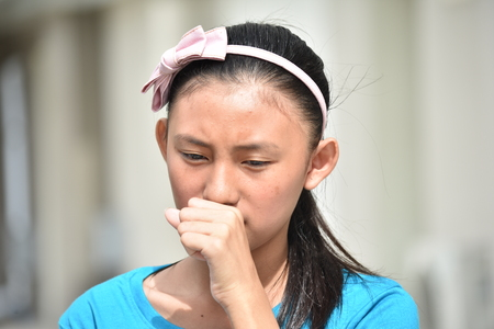 A Coughing Filipina Girl