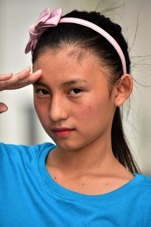 A Teenager Girl Saluting