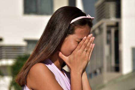 An Ashamed Asian Person