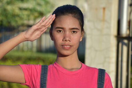 A Saluting Filipina Female