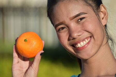 Smiling Attractive Asian Female With Fruit