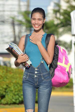 Appreciative Girl Student With Books