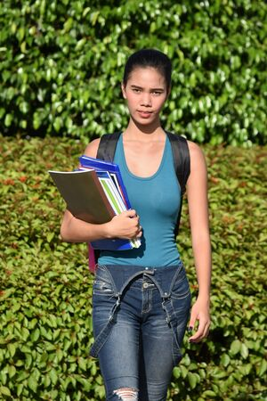 Unemotional Young Filipina Girl Student With Notebooks Reklamní fotografie