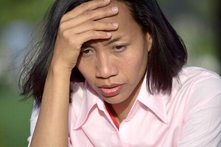 Asian Female And Worry Фото со стока