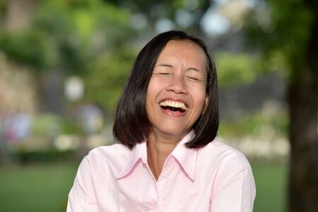 Youthful Asian Female Laughing