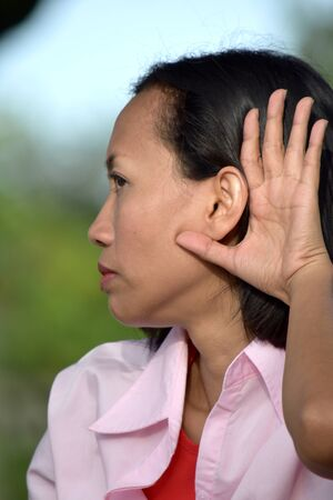 An Asian Female Listening