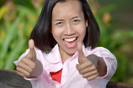 Young Asian Female With Thumbs Up