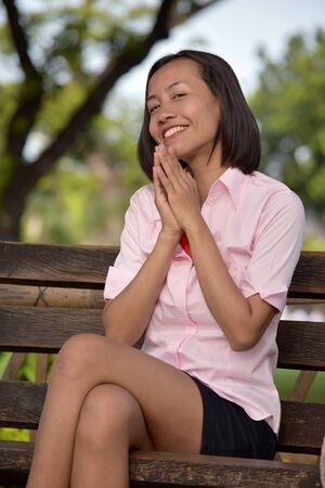A Praying Filipina Female