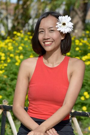 Woman And Happiness With A Flower Stock Photo