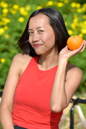 Asian Female And Happiness With Fruit