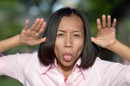 Youthful Filipina Woman Making Funny Faces