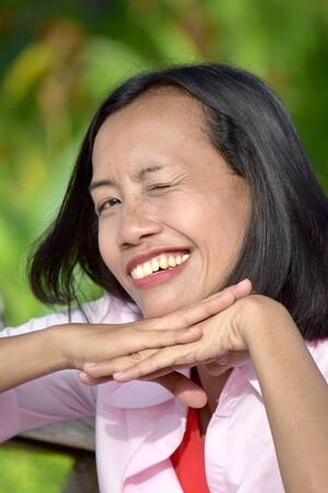 A Filipina Female Winking Stock Photo - 128328739