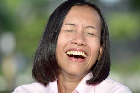 Youthful Filipina Woman And Laughter
