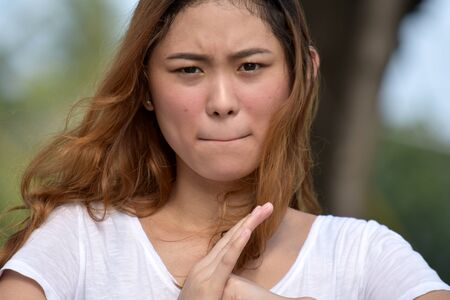 Attractive Asian Adult Female And Anger Stockfoto