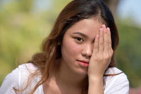 Ashamed Youthful Asian Person Stock Photo