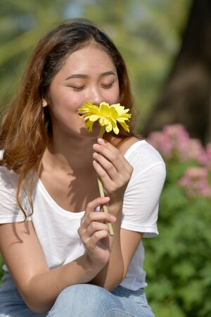 Asian Woman Smelling Flower