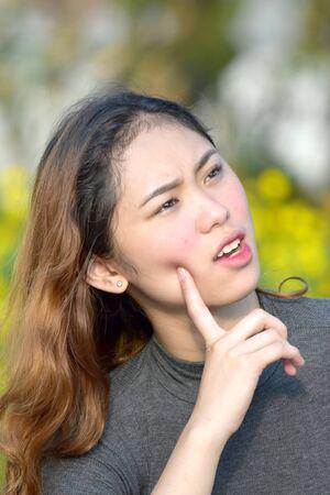 Thoughtful Youthful Filipina Person