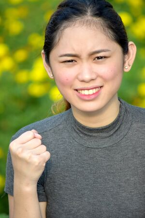 Mad Young Filipina Adult Female Stockfoto