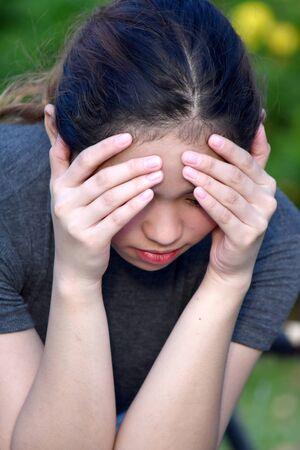 Worried Young Filipina Woman