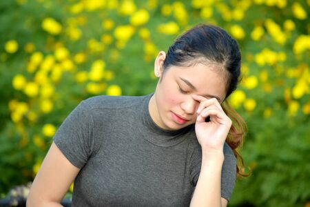A Tearful Asian Person Stock Photo