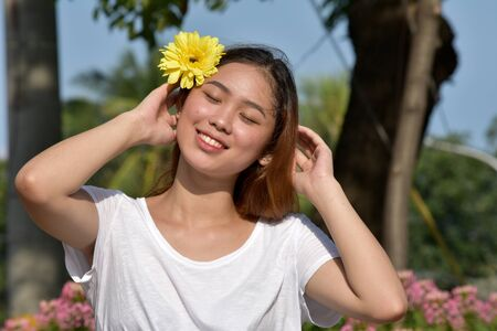 A Smiling Asian Female Stock Photo