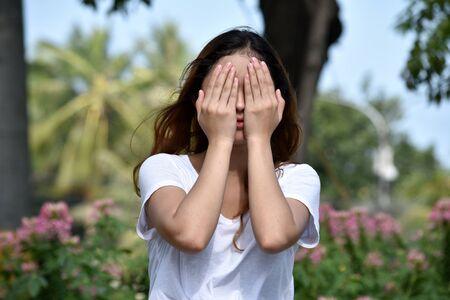 Ashamed Youthful Filipina Female