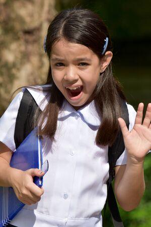 Surprised Young Minority School Girl Wearing Uniform