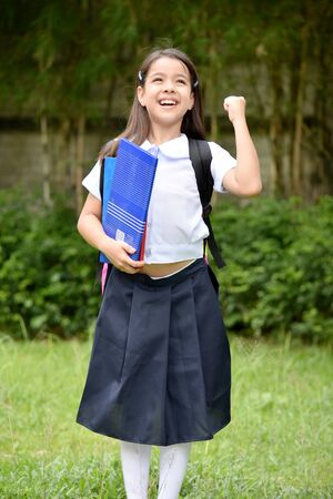 Successful Young Person Wearing School Uniform With Notebooks