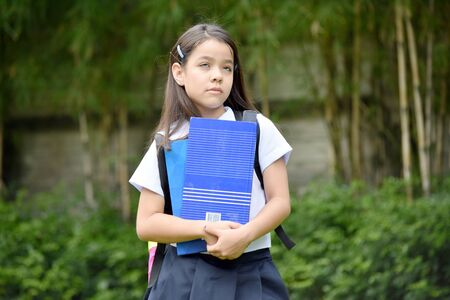 Contemplative Girl Student Wearing Uniform With Books Banco de Imagens
