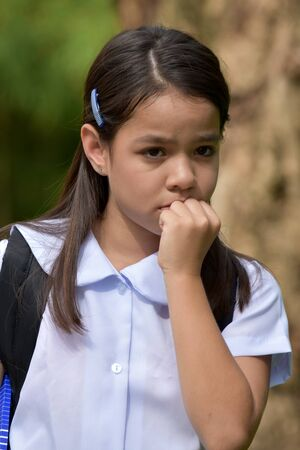 Child Girl Student Afraid Wearing School Uniform With Notebooks Stockfoto