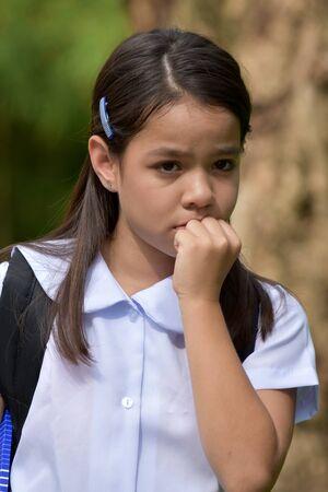 Child Girl Student Afraid Wearing School Uniform With Notebooks Archivio Fotografico