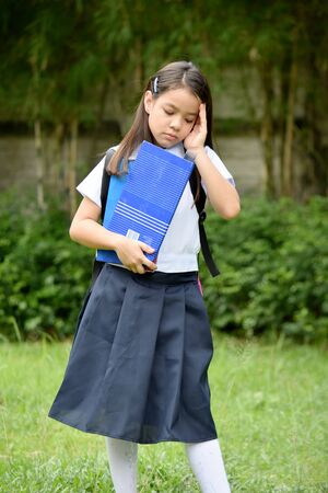 Cute Diverse Female Student And Sadness Wearing School Uniform With Notebooks