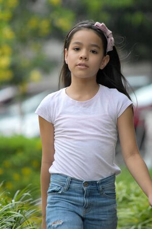 Unemotional Minority Female Walking