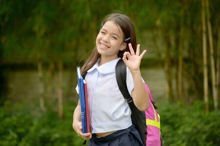 Okay Young Asian School Girl Wearing School Uniform With Notebooks