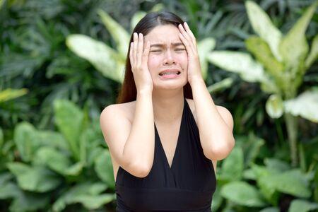 An Asian Female Under Stress