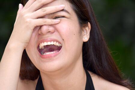 A Youthful Woman Laughing