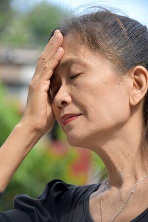 A Depressed Minority Female Senior 写真素材 - 129783616