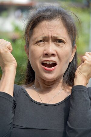 An Anxious Minority Female Senior Stock Photo