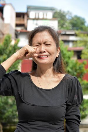 A Crying Female Senior Woman 写真素材
