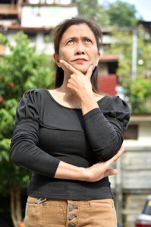 A Thoughtful Female Senior Gramma