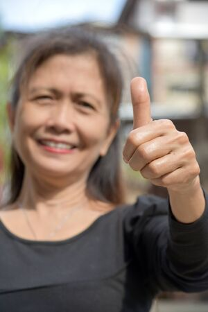 A Granny With Thumbs Up