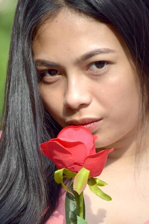 Unemotional Adult Female With A Rose 版權商用圖片