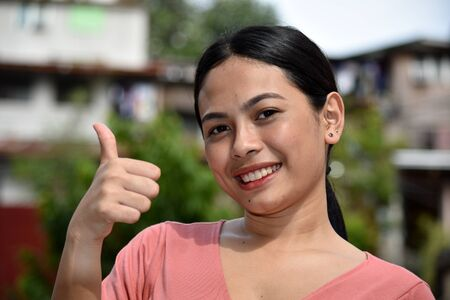 Diverse Adult Female With Thumbs Up
