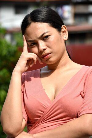 A Pretty Asian Adult Female Thinking
