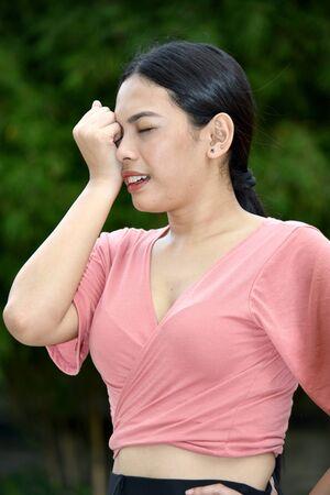 A Stressful Asian Adult Female 版權商用圖片